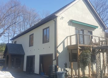 Stucco over cedar siding in Bethesda